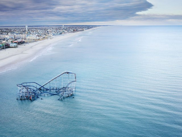 star-jet-roller-coaster-casino-pier-seaside-heights-nj-submerged-in-atlantic-ocean-aerial-stephen-wilkes